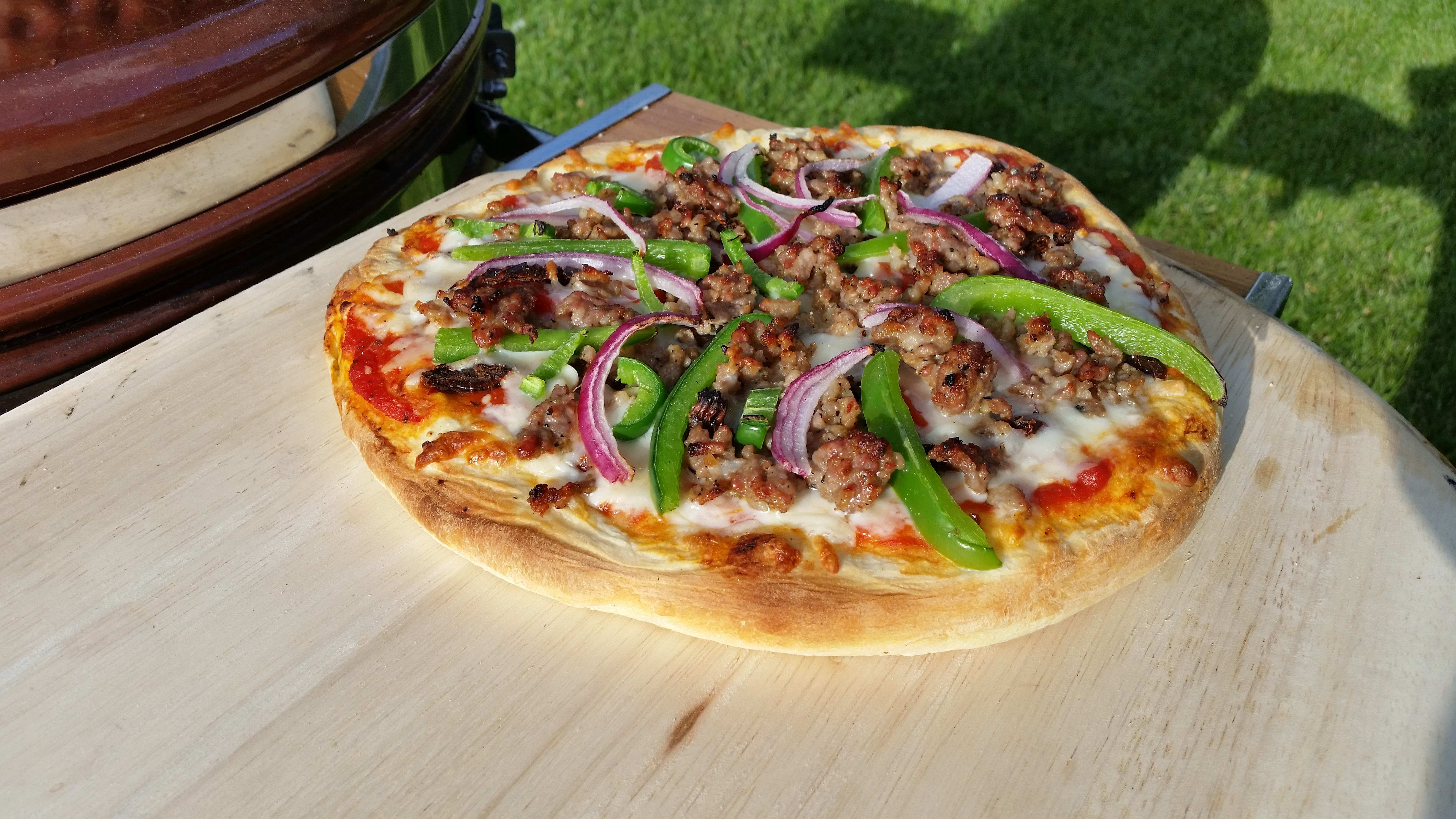 Grilled, Homemade Pizza with Ground Beef, Green Pepper, and Onions