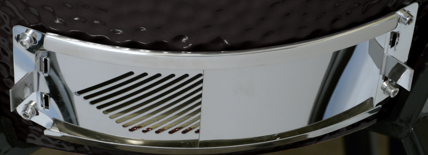 The grill's ash vent is fully open, with the ash guard closed.